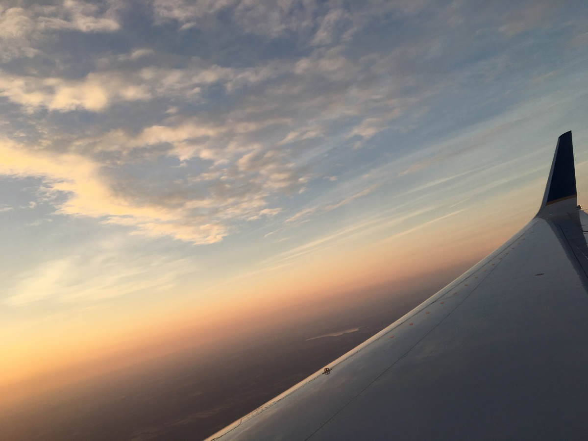 plane flying over the clouds