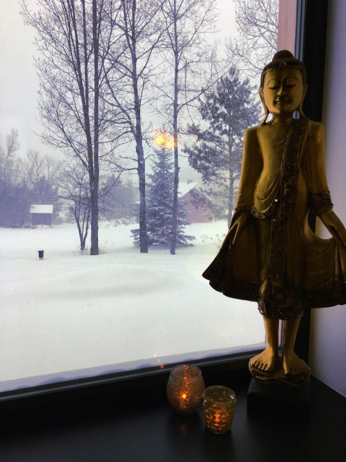 Buddha in the Window during a snow storm