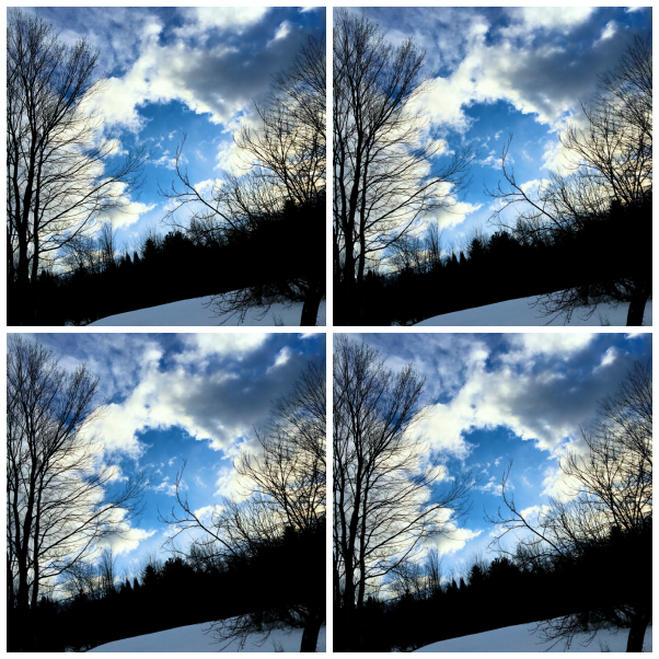 Blue sky and clouds over the snowy hill