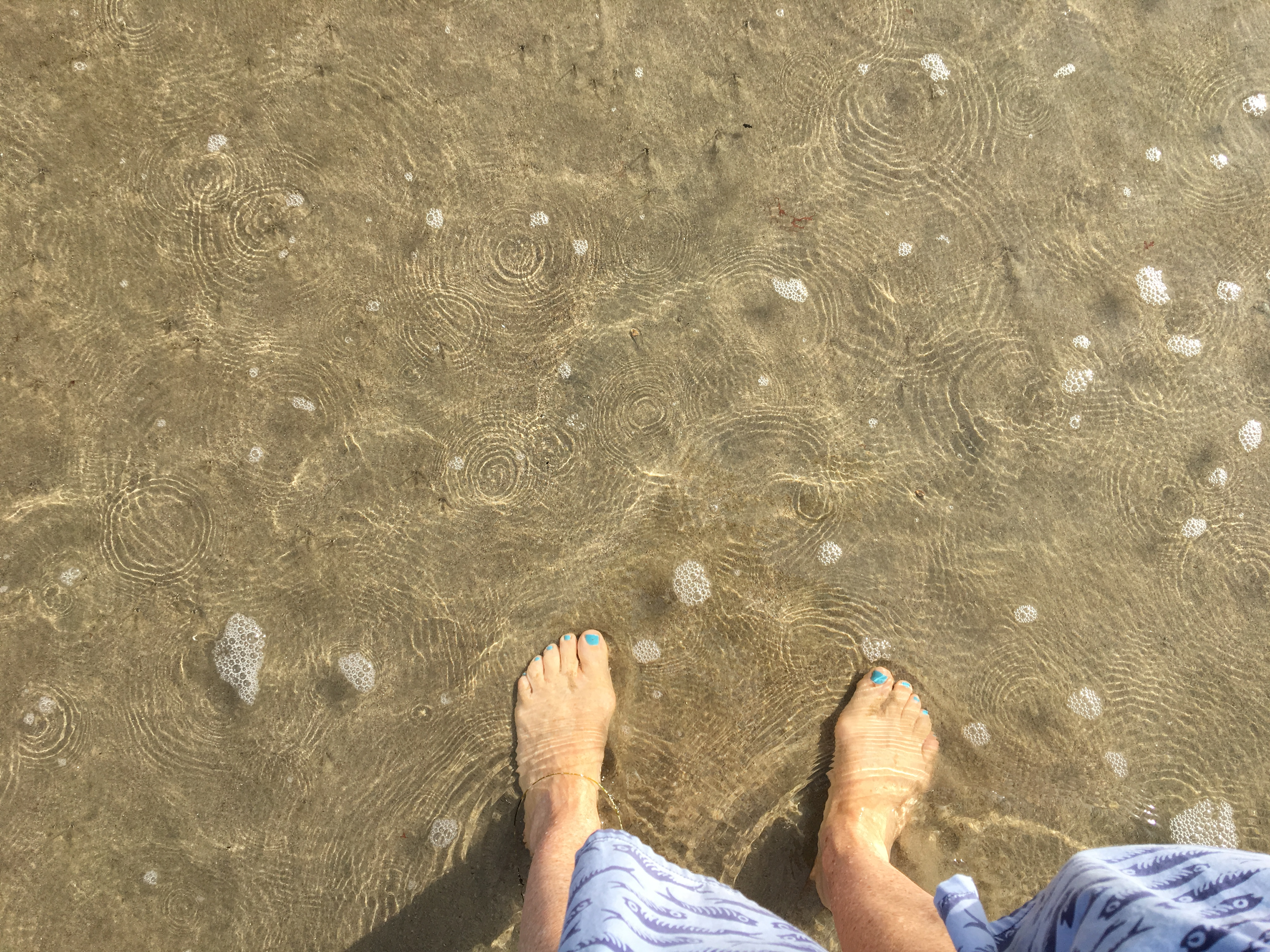 feet in the sand on Santa Monica beach