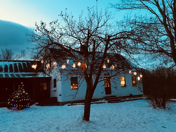 Vermont farmhouse with snowflake lights