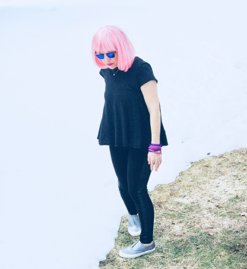 snow surrounding model with a pink wig